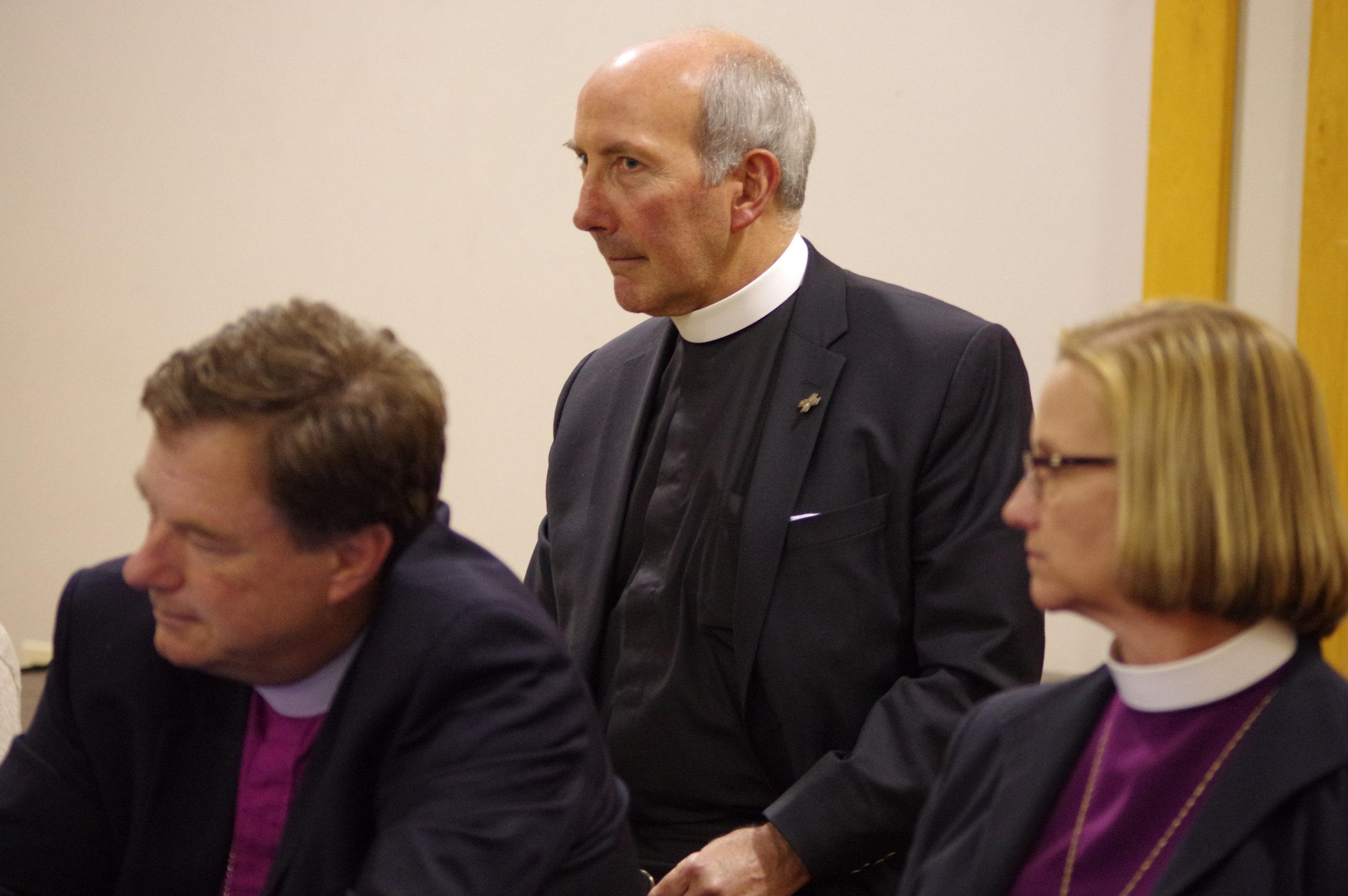 The Rev. Canon George F. Woodward III, center / Photo Glen Mitchell