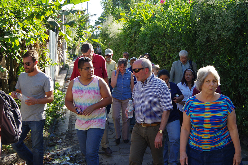Woodward, second from the right, visits a Salvadoran community with other board members.  / Photo Glen Mitchell