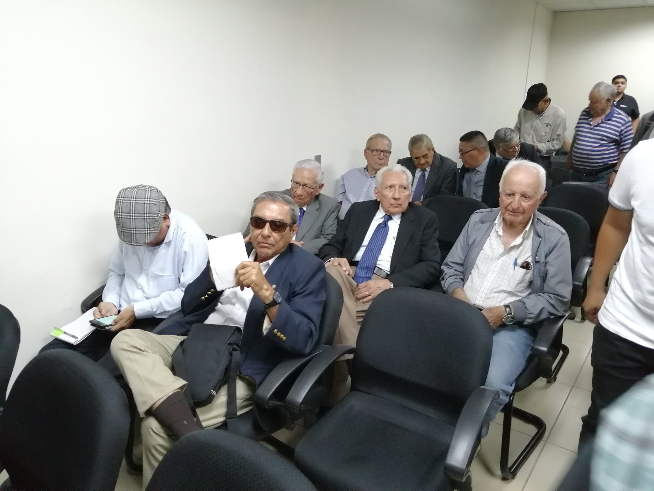 Generals implicated in the El Mozote Massacre listen to the charges against them at a hearing in San Francisco Gotera, Morazan on July 18, 2019.