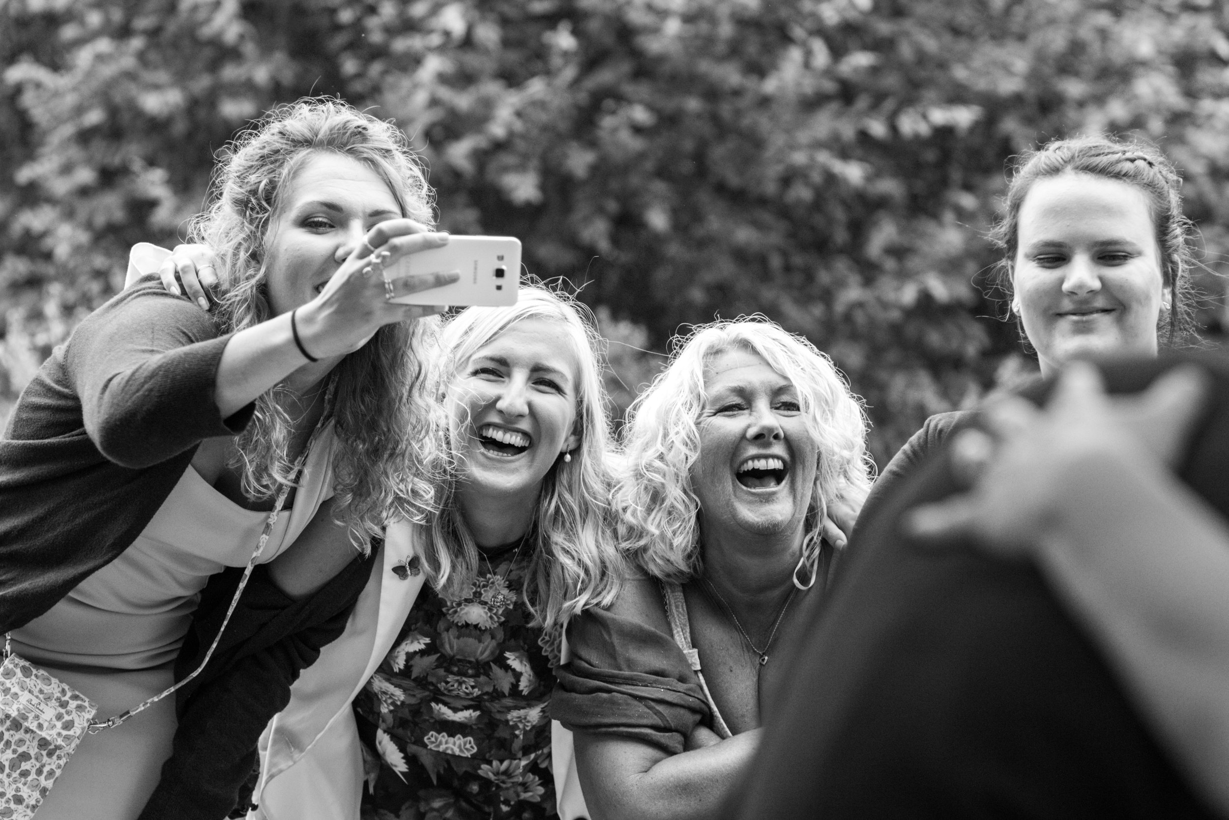 Guests selfie time, UK festival wedding photography