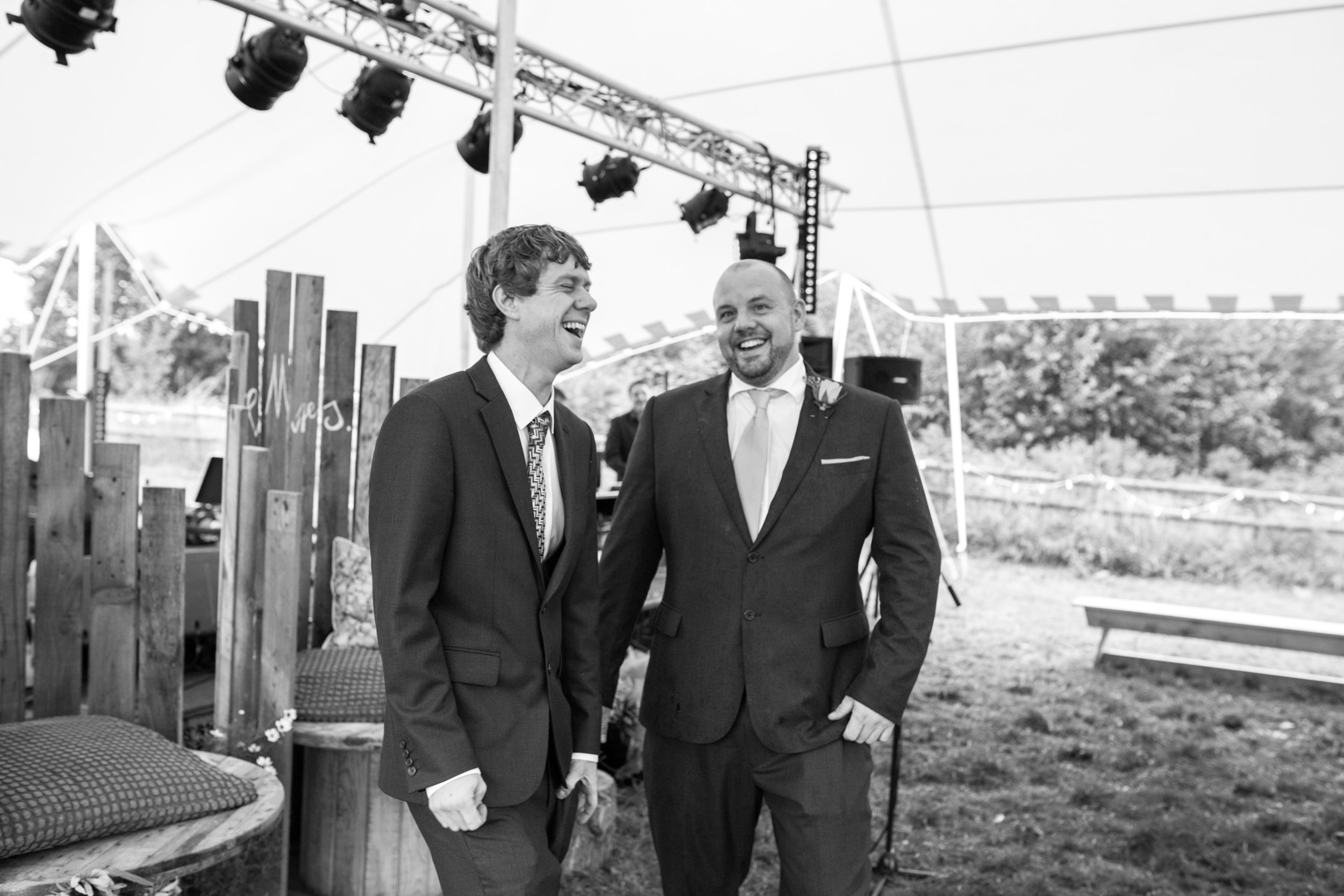 Groom and Best man share a laugh, Shropshire festival wedding photography
