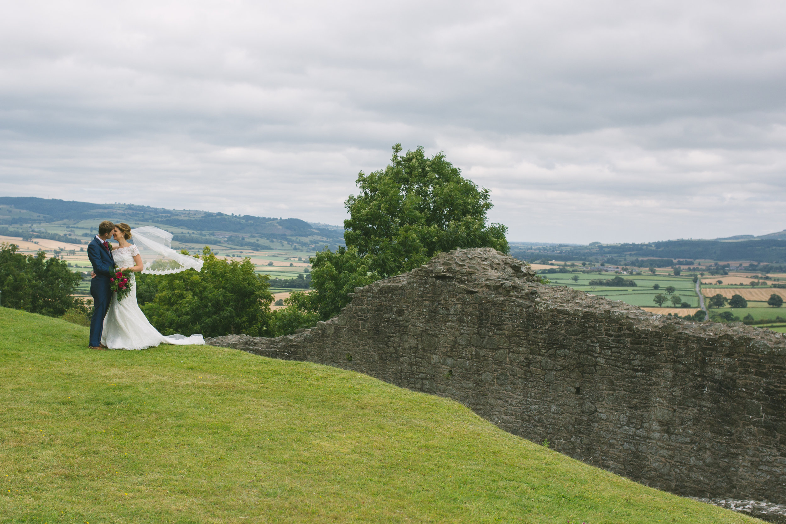 Bride and Groom with view of Wales