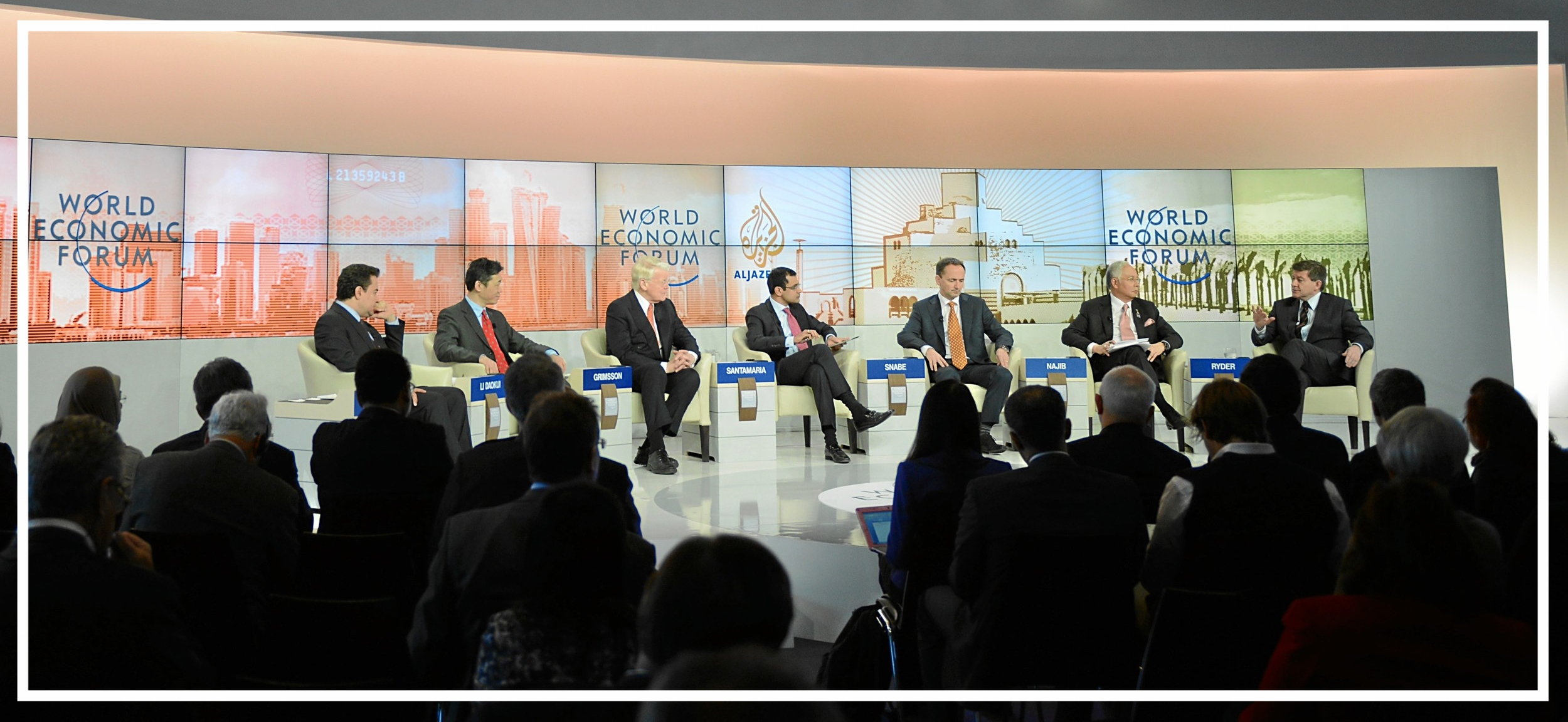 Moderating a televised panel at the World Economic Forum, (Davos, 2013)