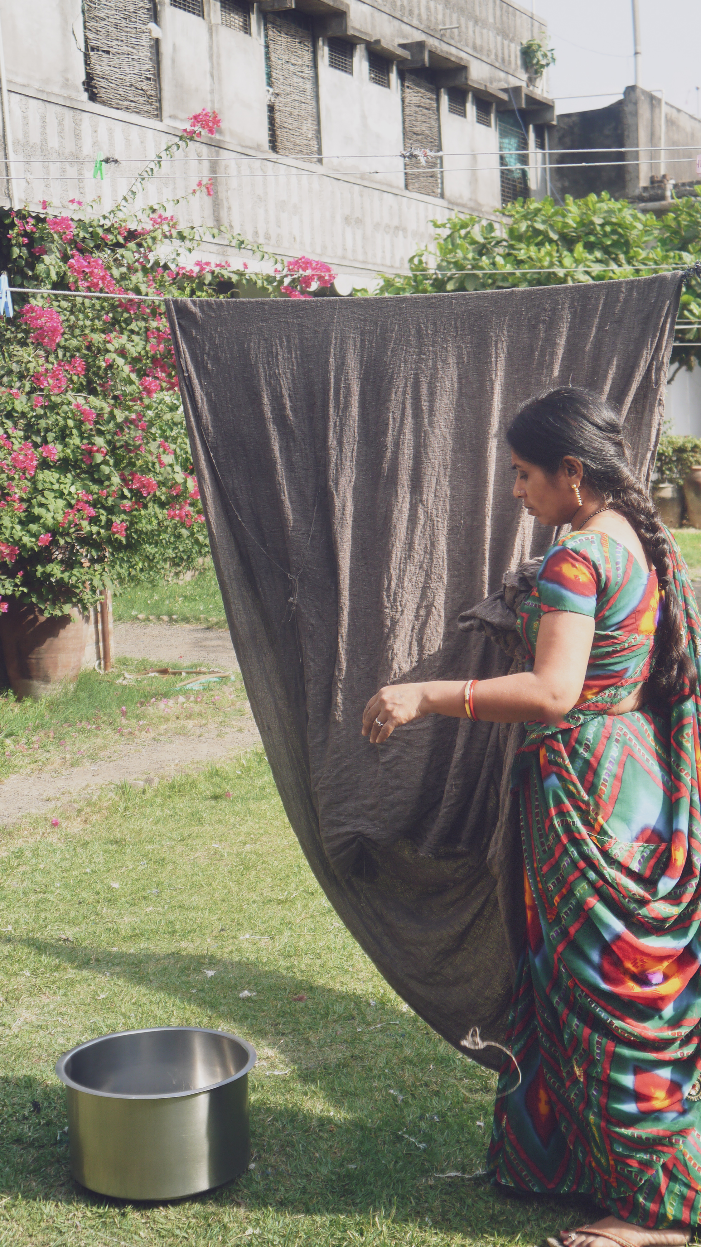 lady hanging our fabric.jpg