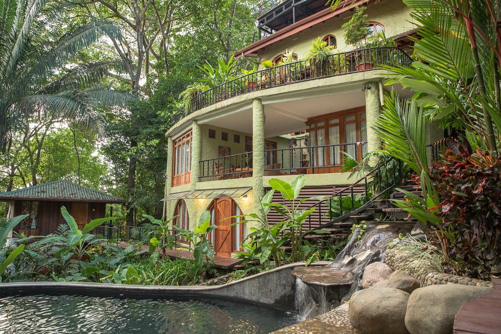 Casa de las Brisas in Costa Rica. The home for the Barkarica experience. This is the view from the largest of 3 pools towards the back of the house.