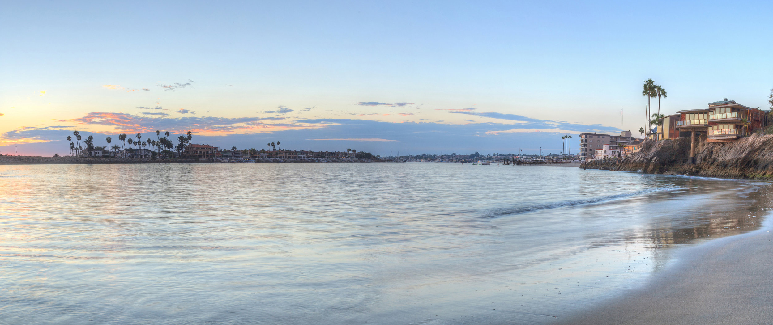 Corona del Mar beach looking towards Newport Beach and Balboa Island. Picture yourself here on night one photographing dogs under these amazing skies as the sun sets. <insert squeal here>