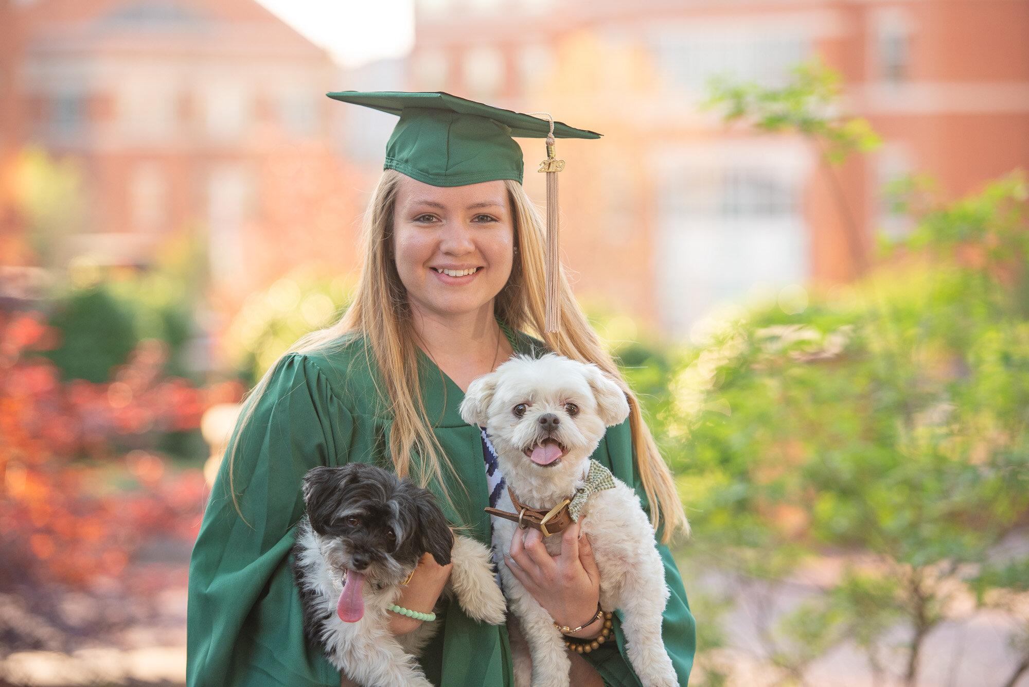 senior photo UNCC grad with dogs