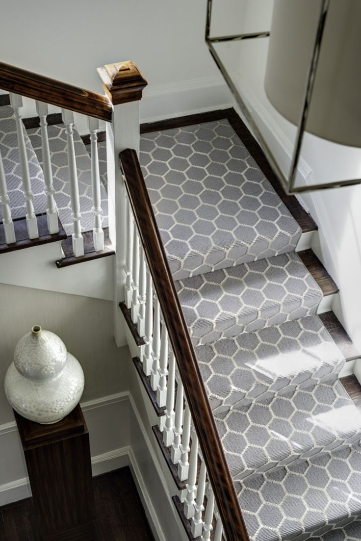 A stair runner can make a brilliant addition to slippery staircases not to mention a dramatic statement in the foyer. Just make sure they're properly attached   Via BDHM