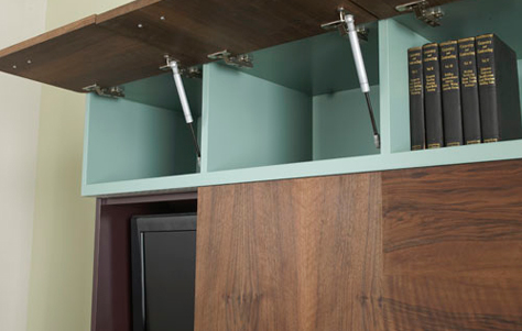 Easy lift upper cabinets provide further storage for lesser used objects | Photo courtesy Think Fabricate