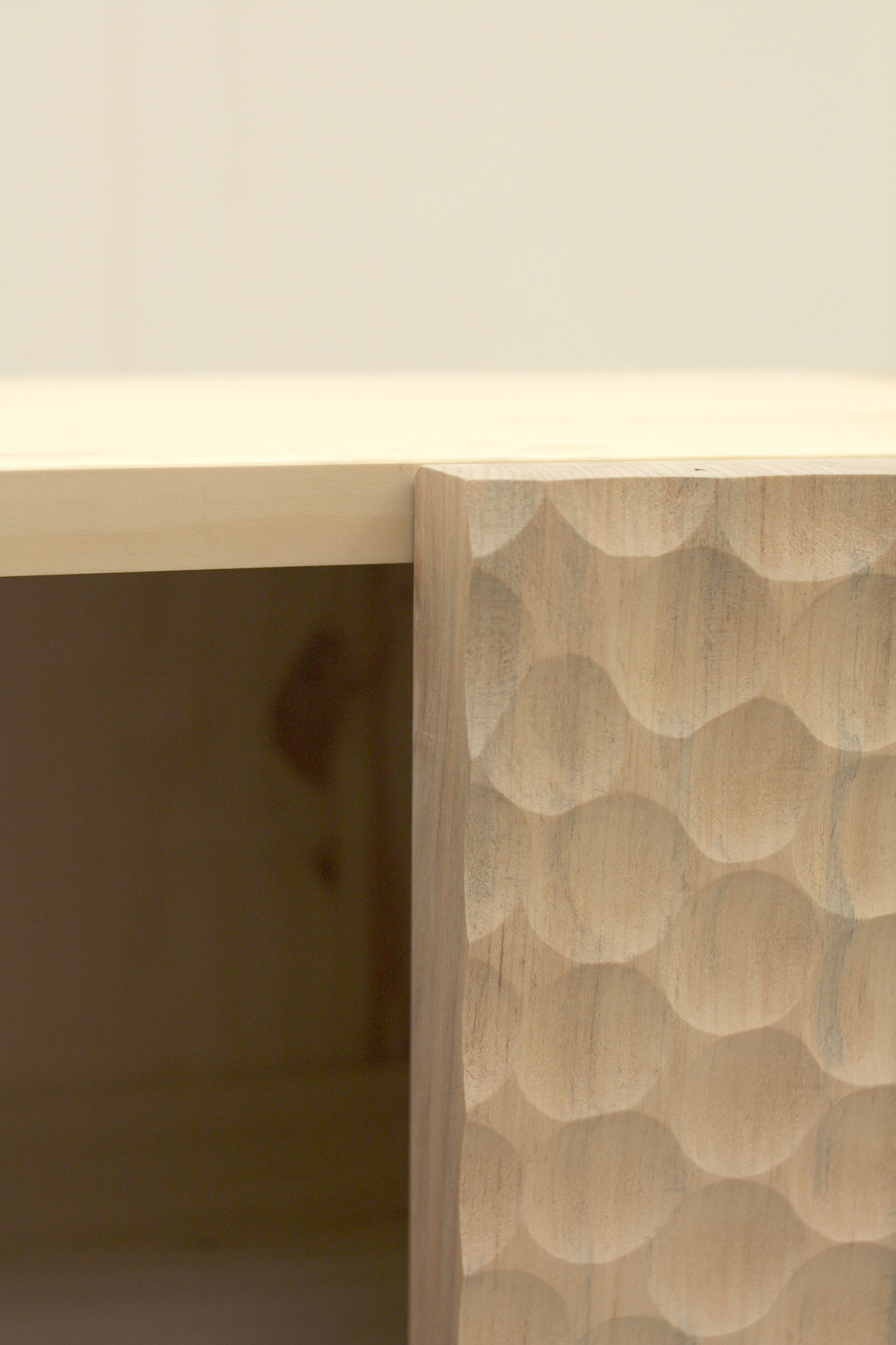 Adzed detail on the curved Sycamore and Lime Cabinet doors