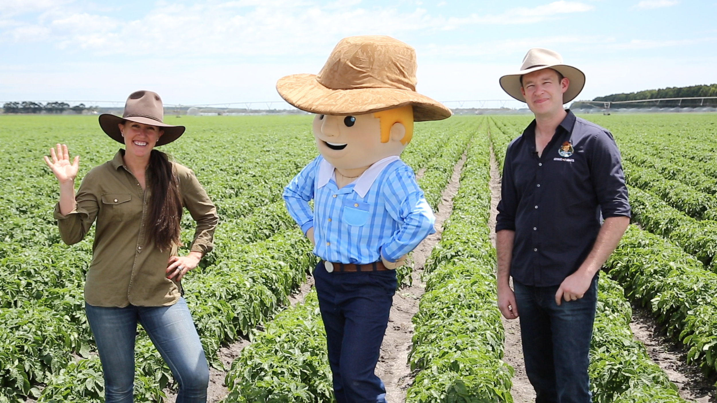 Simone and business partner Ben with George the Farmer.