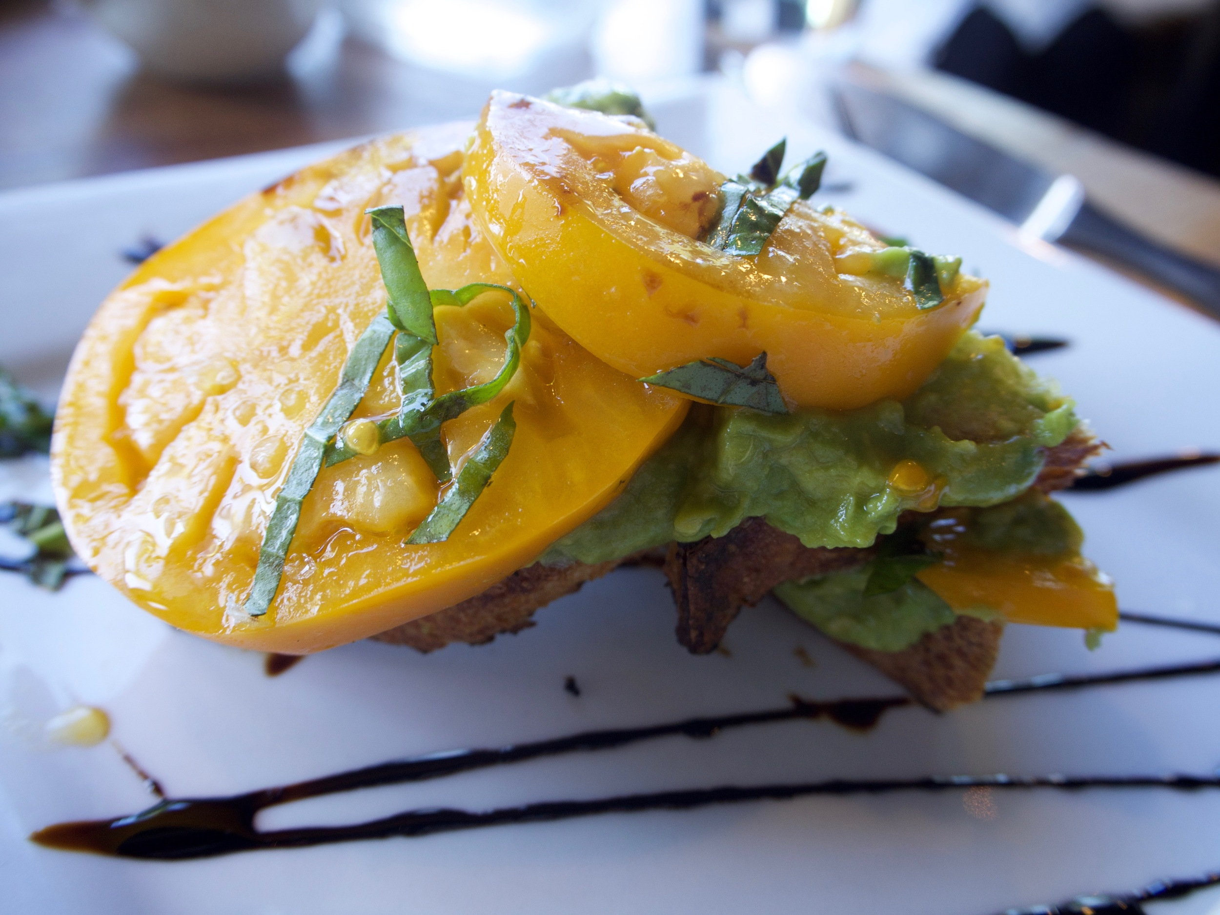Neighborhood spot in Berkeley with a gorgeous avocado toast, heirloom tomatoes, basil and balsamic reduction