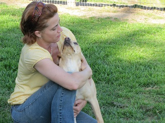 """RENAE  has been at SCPR since 2008. She still loves her job, and you can tell. Always an animal person, this is her dream job. She loves being outside, meeting new people, and of course, giving lots of hugs and kisses to our furry guests. """"I hope to be here many more years, doing what I love"""""""