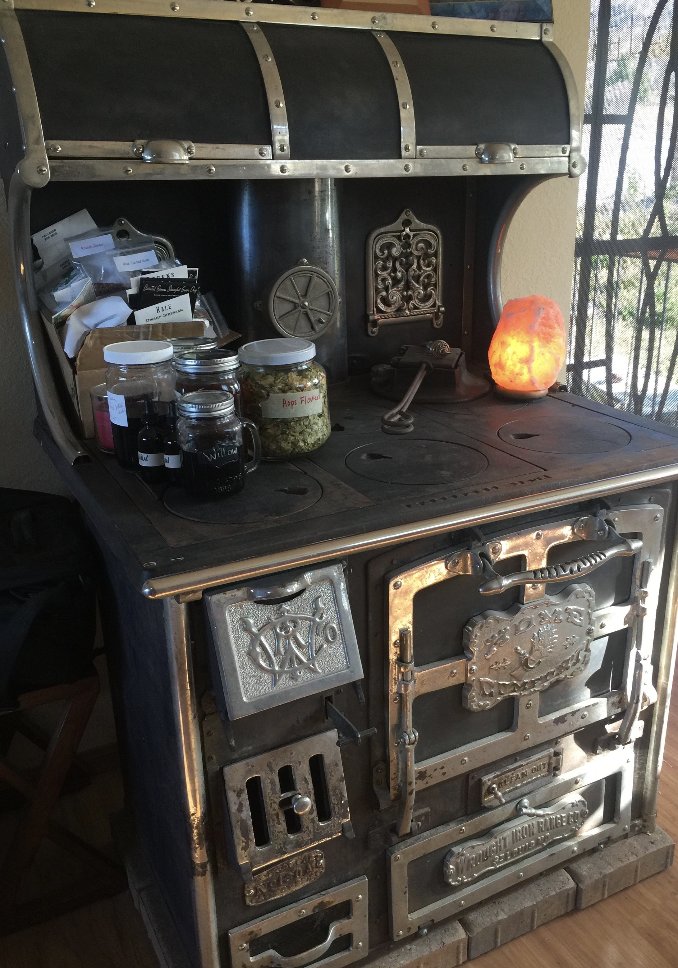 Here is our stove. Sorry---I've got some of my tinctures, herbs, and seeds up there right now. It's summer, after all!