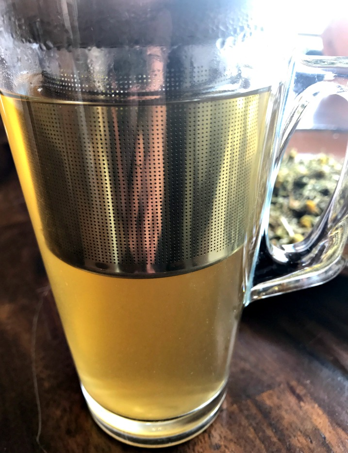 Here some of this tea infusing in  my favorite tea infuser cup . I love this cup, and I keep meaning to buy another one. The infuser is large, allowing the tea leaves to expand, and it's heavy duty glass.
