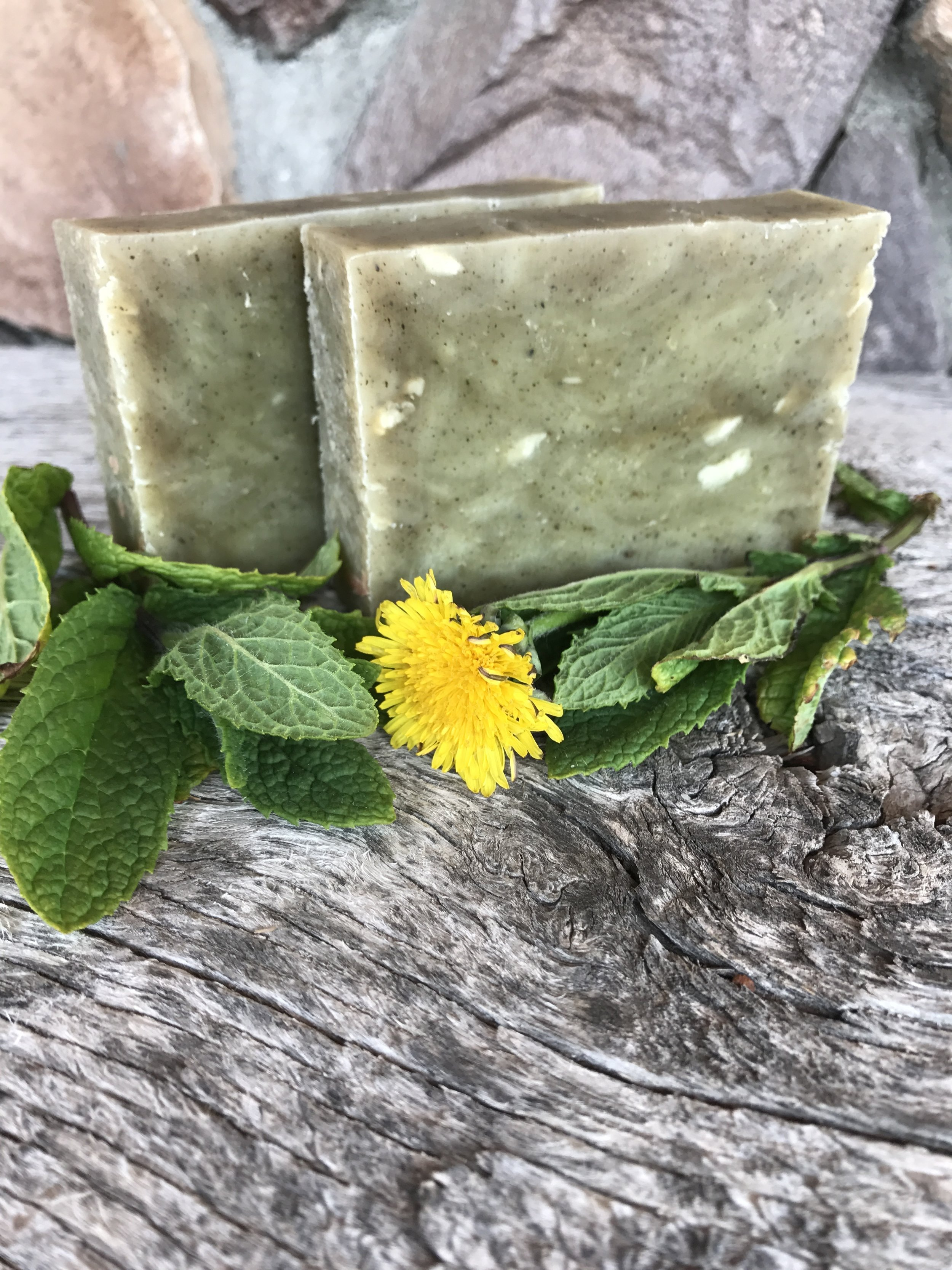 This soap is colored with Nettle powder and is scented with Frankincense, Spearmint, and a touch of Patchouli.