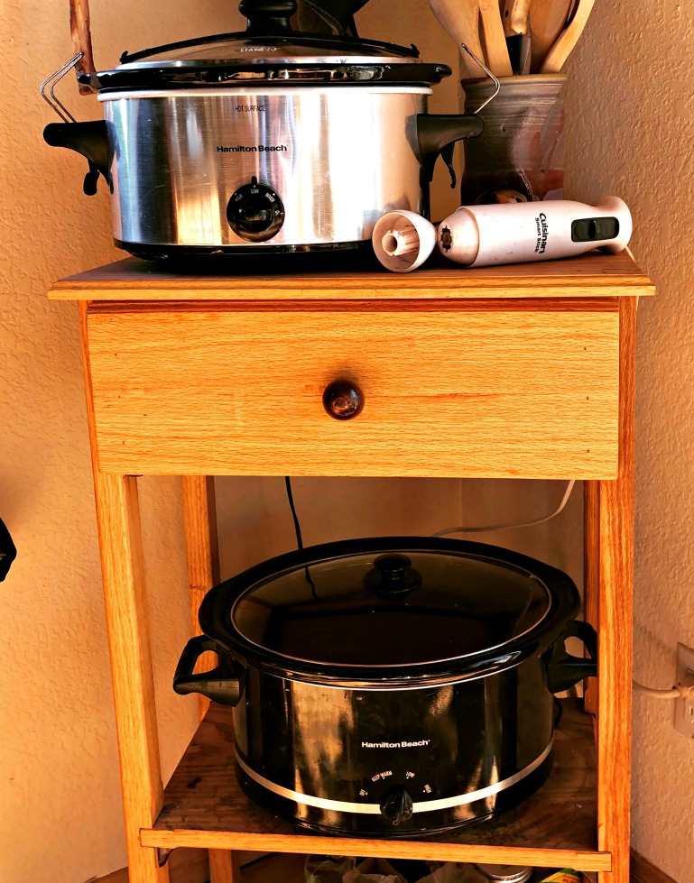 Here's my actual soap making set up! Two crock pots on a double shelf. My neighbor made this for me, and it's pretty perfect. I have to take the bottom crock pot off, though, when it's got soap in it. I just put it on the floor while the soap is cooking!