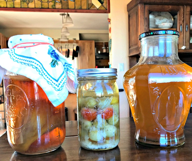 Three different ferments going on in my kitchen, among others!  Kombucha , lacto-fermented green tomatoes, and  raw apple cider vinegar !