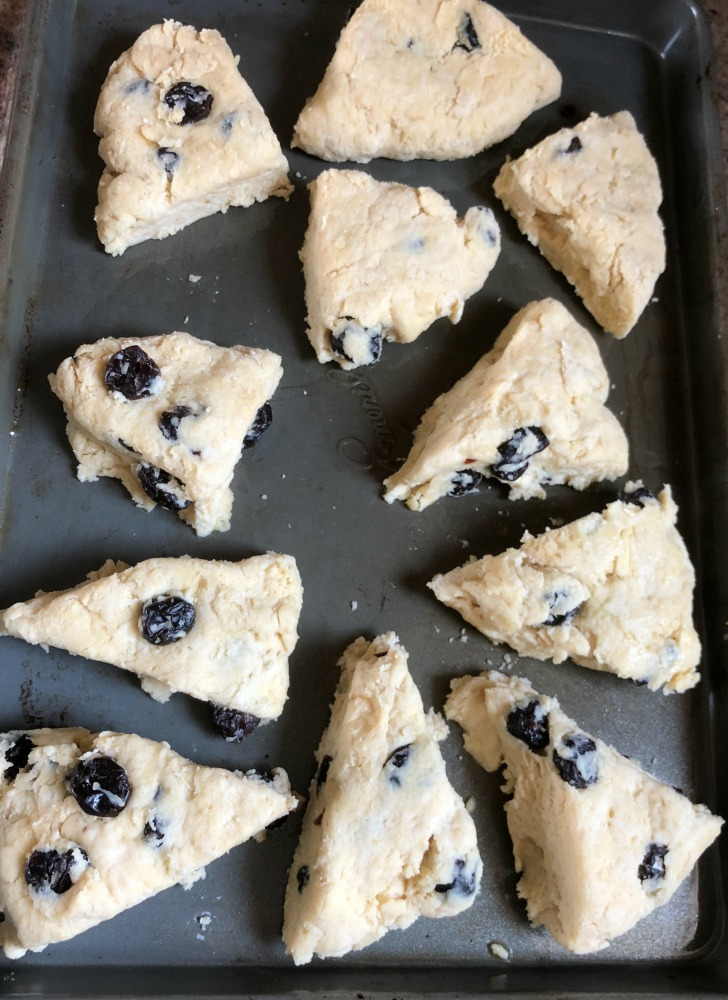 Uncooked scones on the pan.