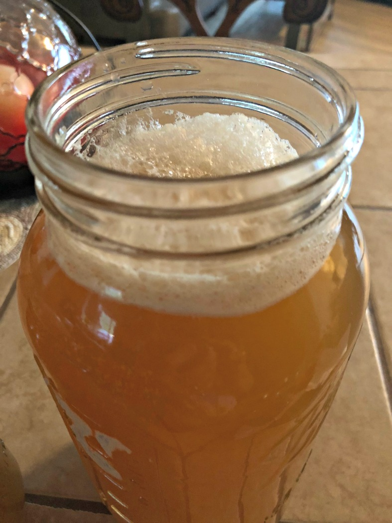 Strain out the fruit & spices---and there you go! Fizzy flavorful kombucha!