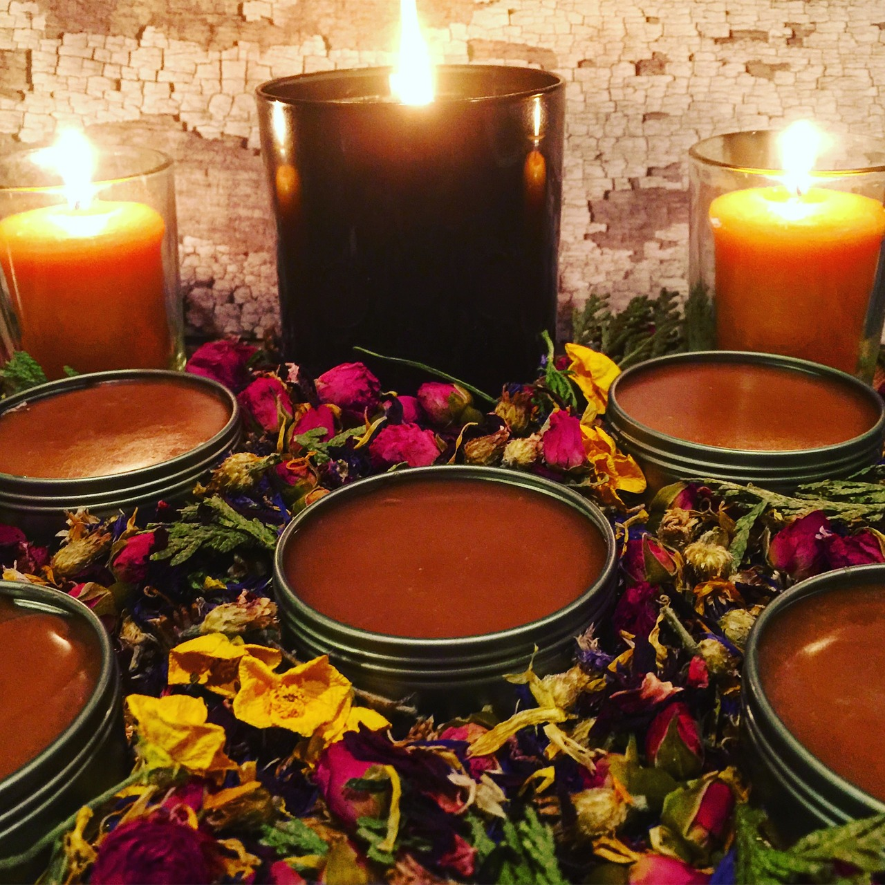 Some herbal preparations, like these salves, can be created using both herbs and essential oils for exceptional efficacy.