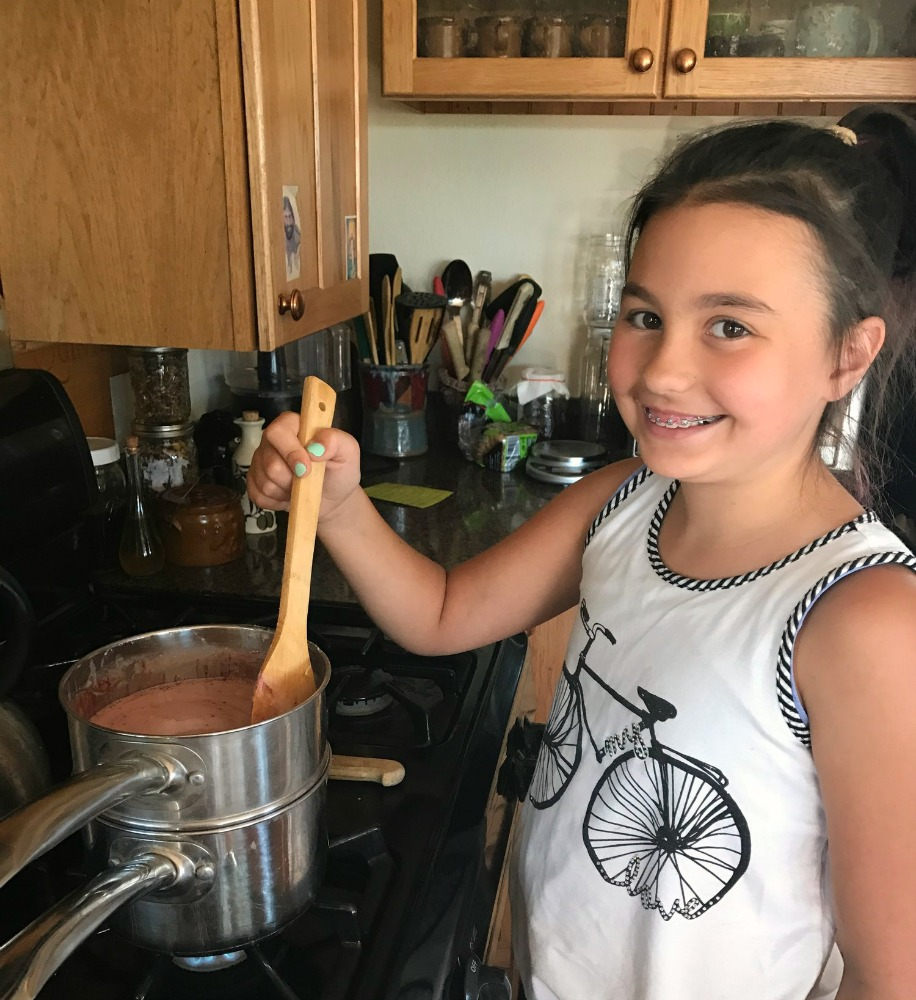 Here is my grand daughter---We are making melt and pour soap! This is a great project to do with kids of any age.