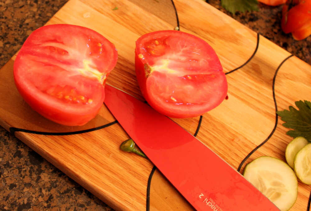 If your tomatoes are too big for the jar top, like this one was, then just cut in half and skip the piercing.