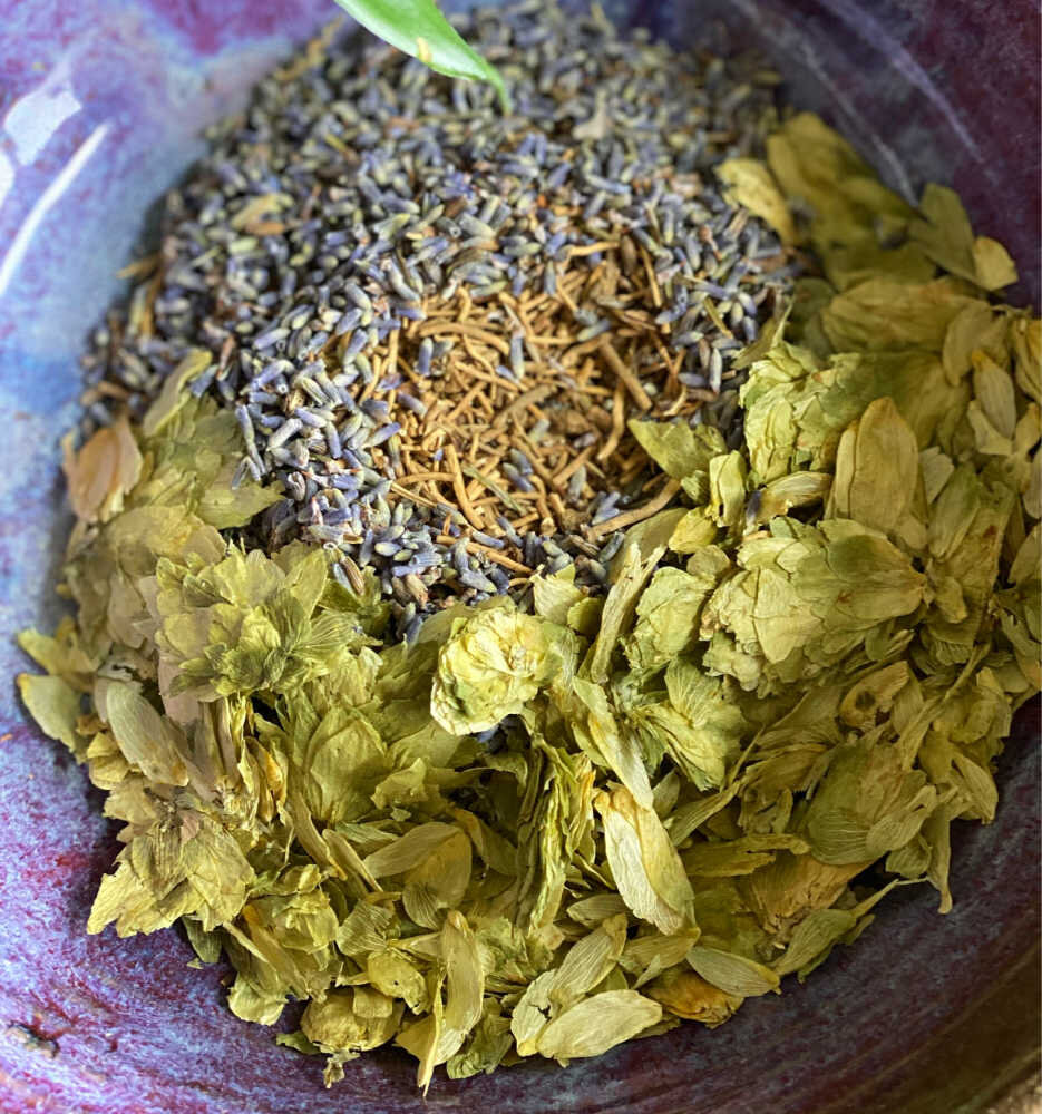 The herbs being blended in a bowl.