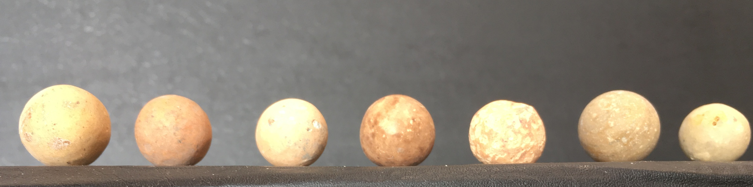 Clay marbles of many shapes and colors