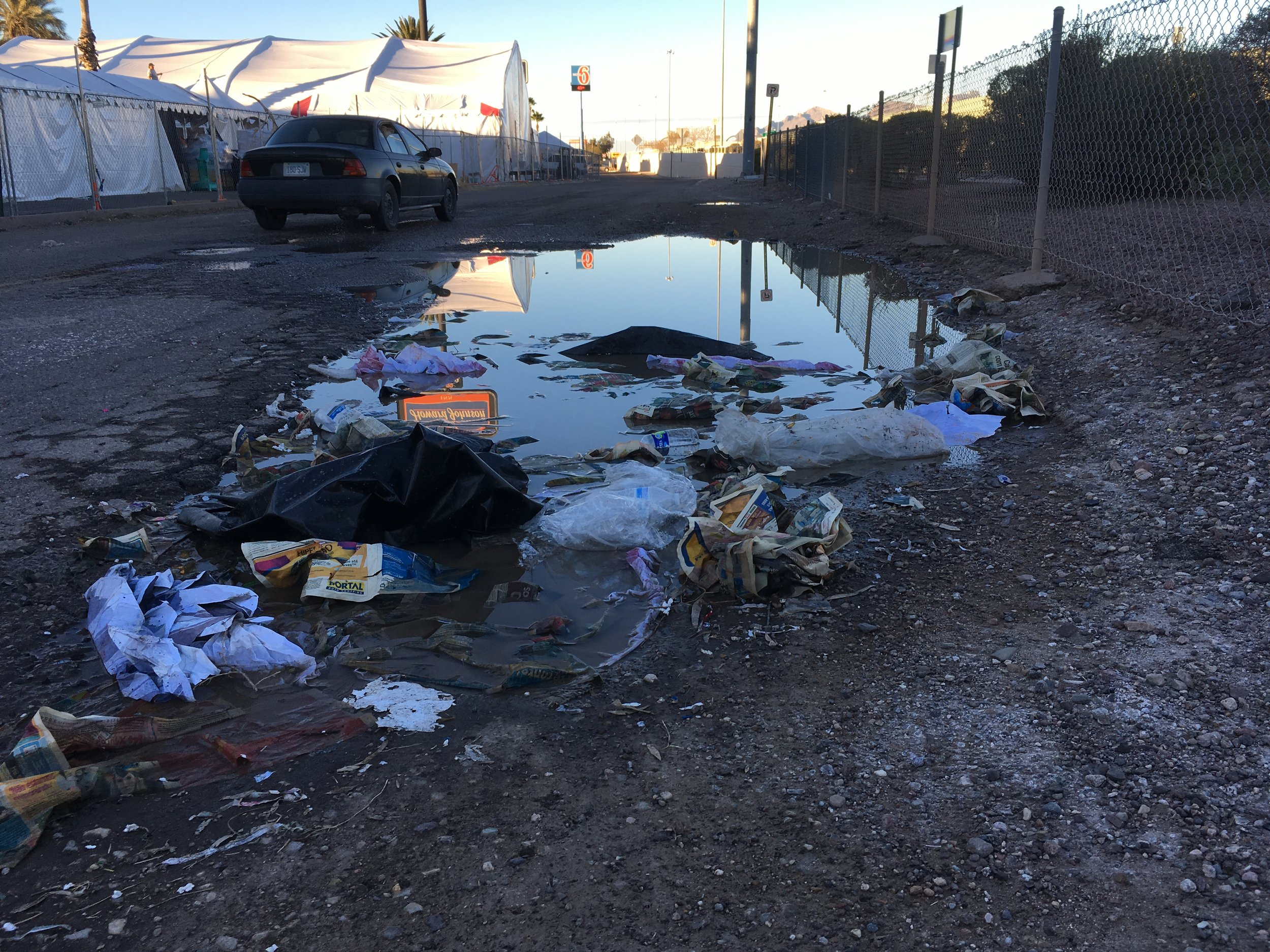 """Last Friday and again Sunday I decided to take my daily walk along the I-10 frontage road, and along Congress and 22nd streets west of Church Avenue. All of these are stretches that will be heavily traveled by pedestrians visiting gem and mineral shows in the next couple of weeks.  Over five hours I picked up 50 or so grocery bags of trash, everything from broken liquor bottles to socks. And I couldn't get close to finishing the job, especially on the south end of the I-10 frontage road, where this photo was taken.  I understand that the state and city cannot keep the roads repaired, much less regularly tend to the litter. But the gem and mineral shows are one of the main economic events of the year. Does no one in government or business give a thought to how Arizona and Tucson appear to these important visitors? I include business in this criticism because there was LOTS of trash in front of the freeway hotels that make money from the gem shows.  To be clear, my complaint isn't about the core of downtown. The Downtown Partnership's """"purple people"""" (identifiable by the color of their shirts) do a good job keeping the streets clean in the restaurant and entertainment districts along Broadway and Congress. Ditto for the area around the Tucson Convention Center. But go west into gem show territory and the garbage is gross."""