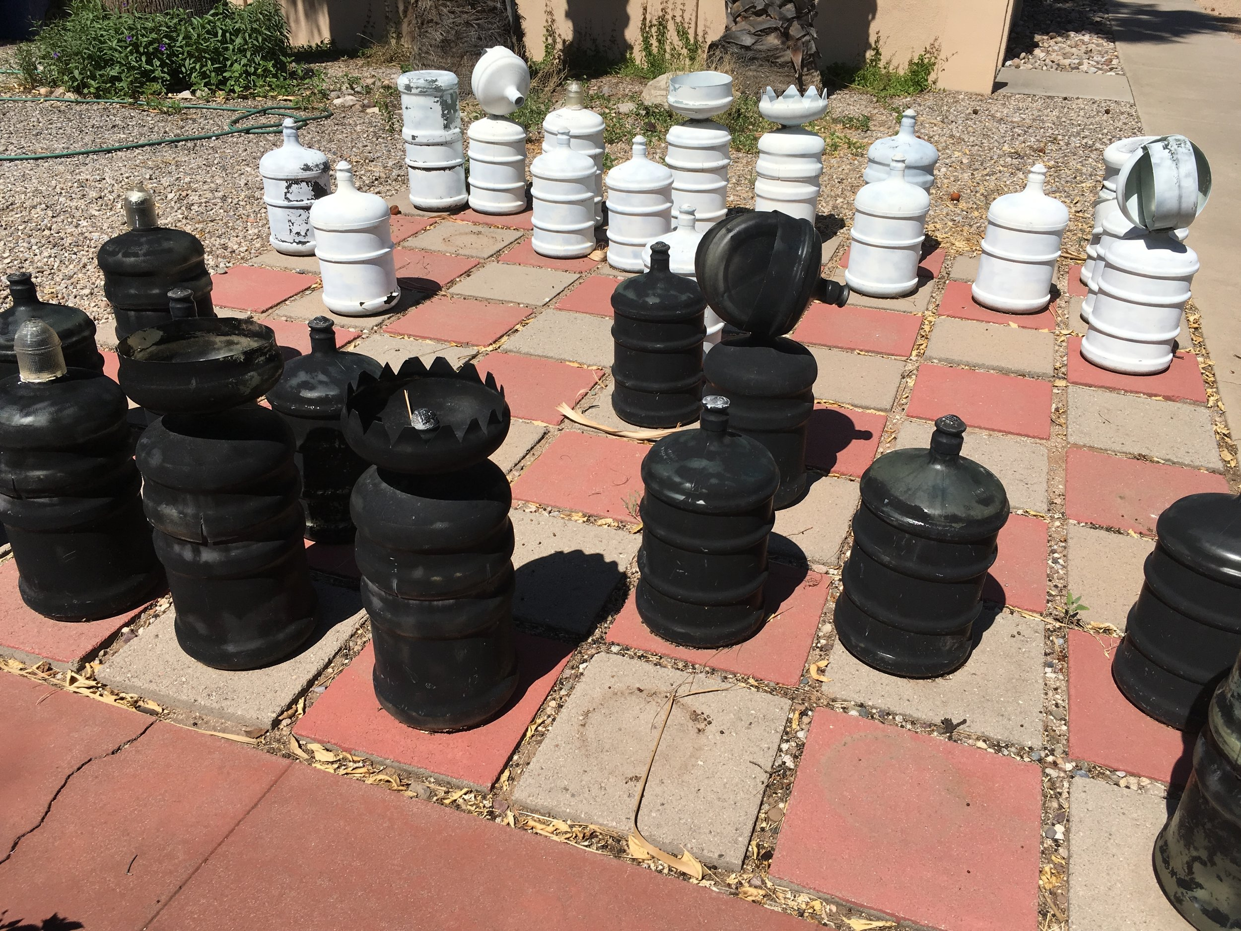 These old water jugs have taken a beating from the desert sun, but they were a fun idea. Sam Hughes neighborhood.