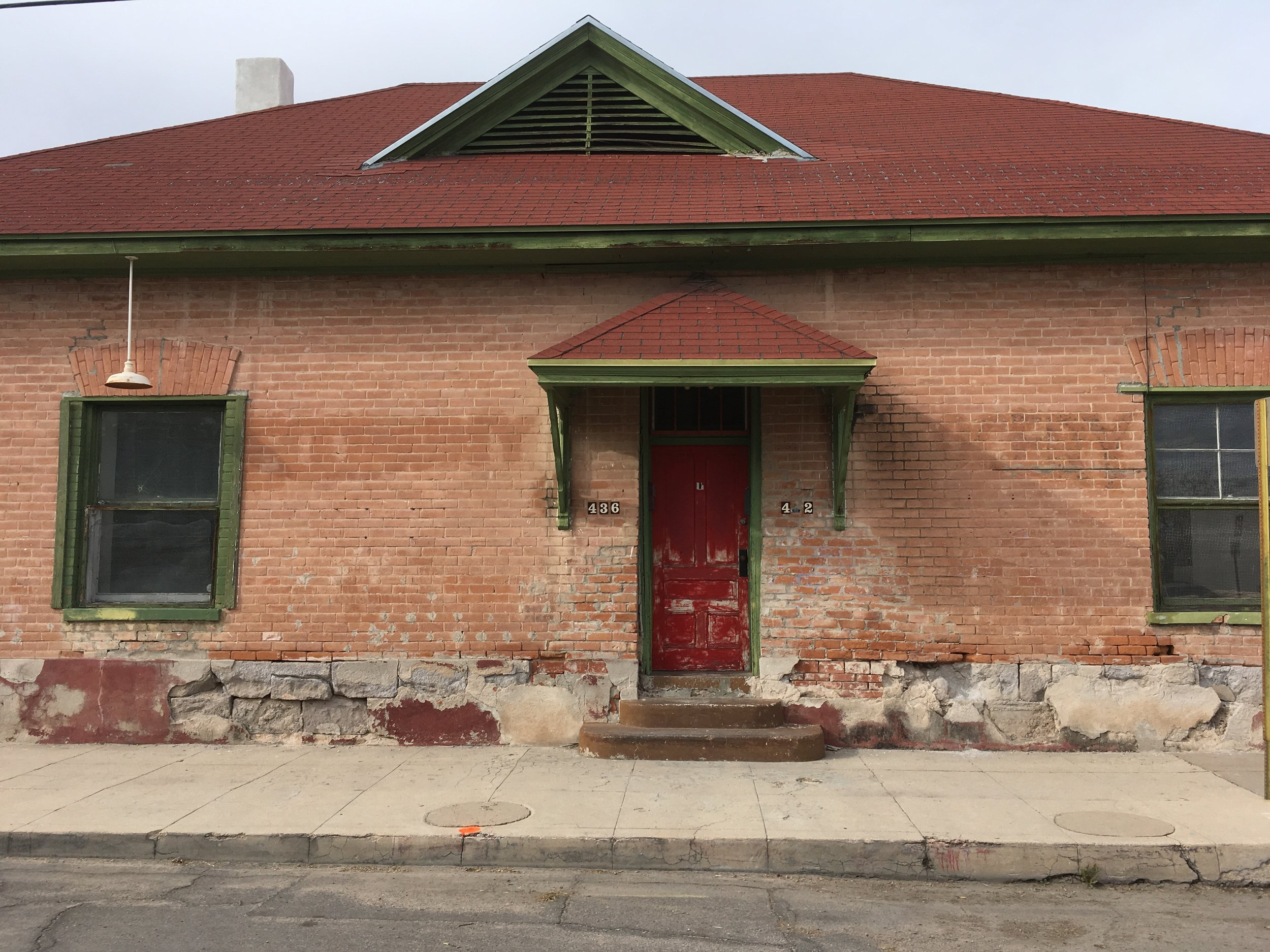 Sadly, the front of 432-436 S. Convent is in danger of collapse. It is difficult to tell from this photo, but the brick and stone along the bottom of the building are popping out. December 2018.