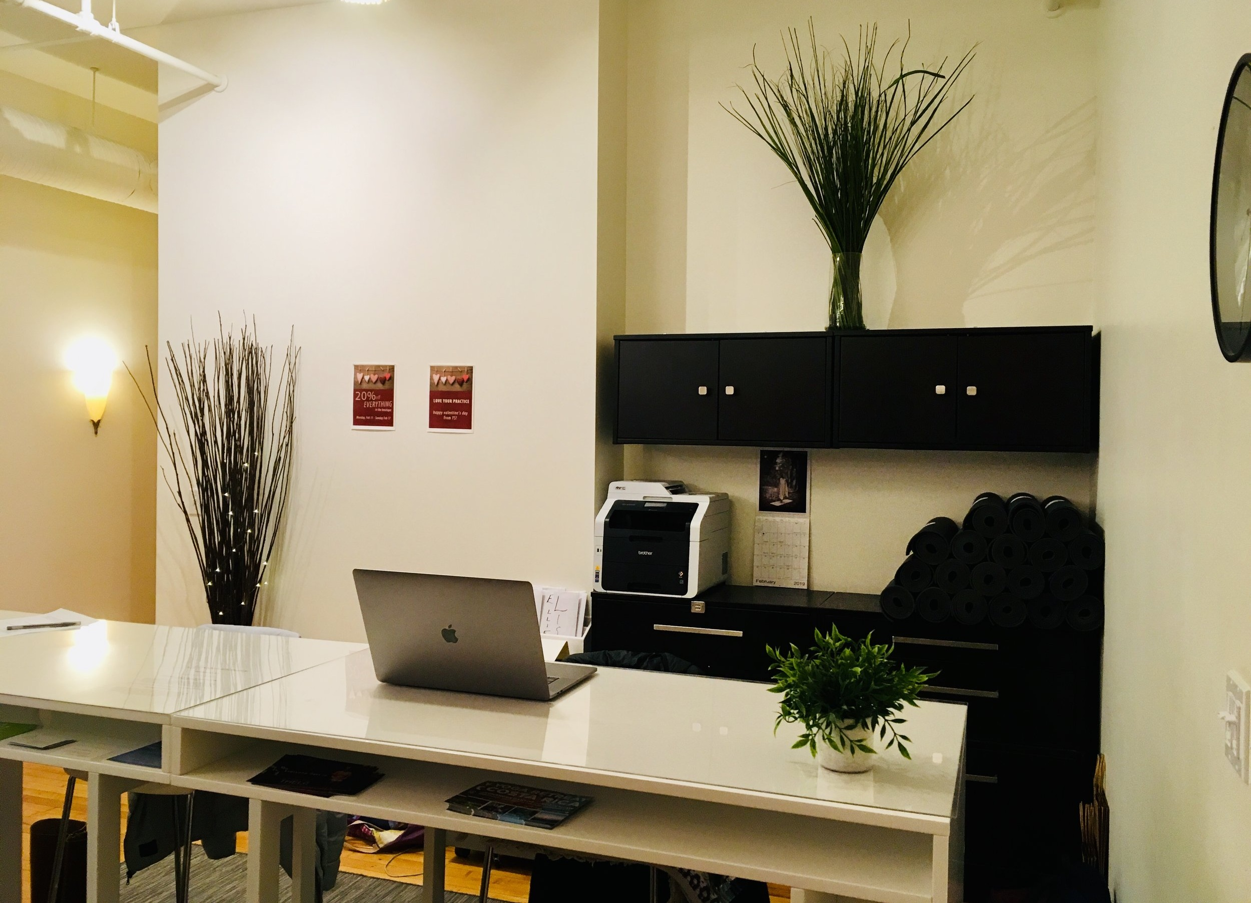 see the neatly rolled rental mats behind the desk? coming soon!