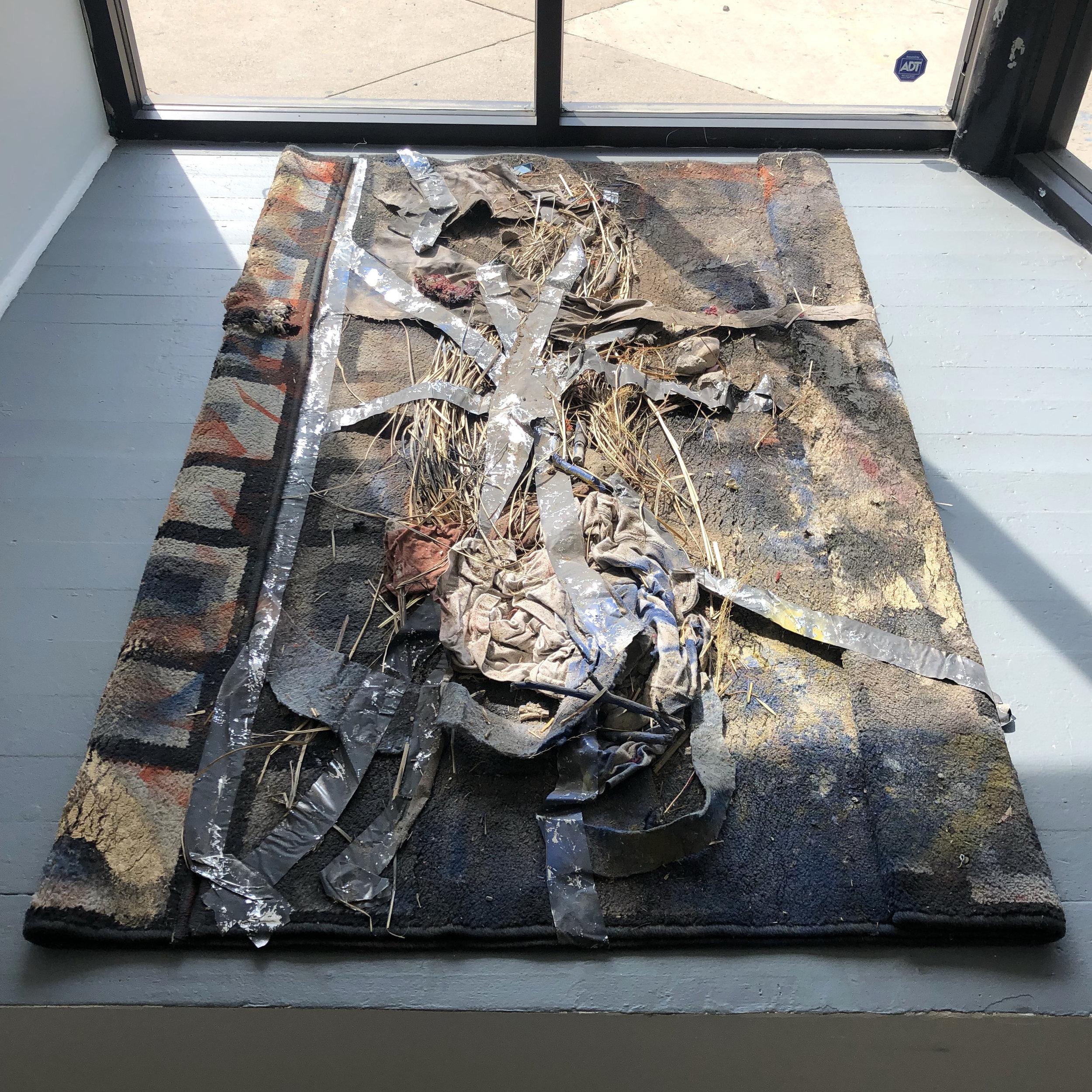 Tasseography , 2016 studio debris, tape, rug 39 x 62 x 1 in