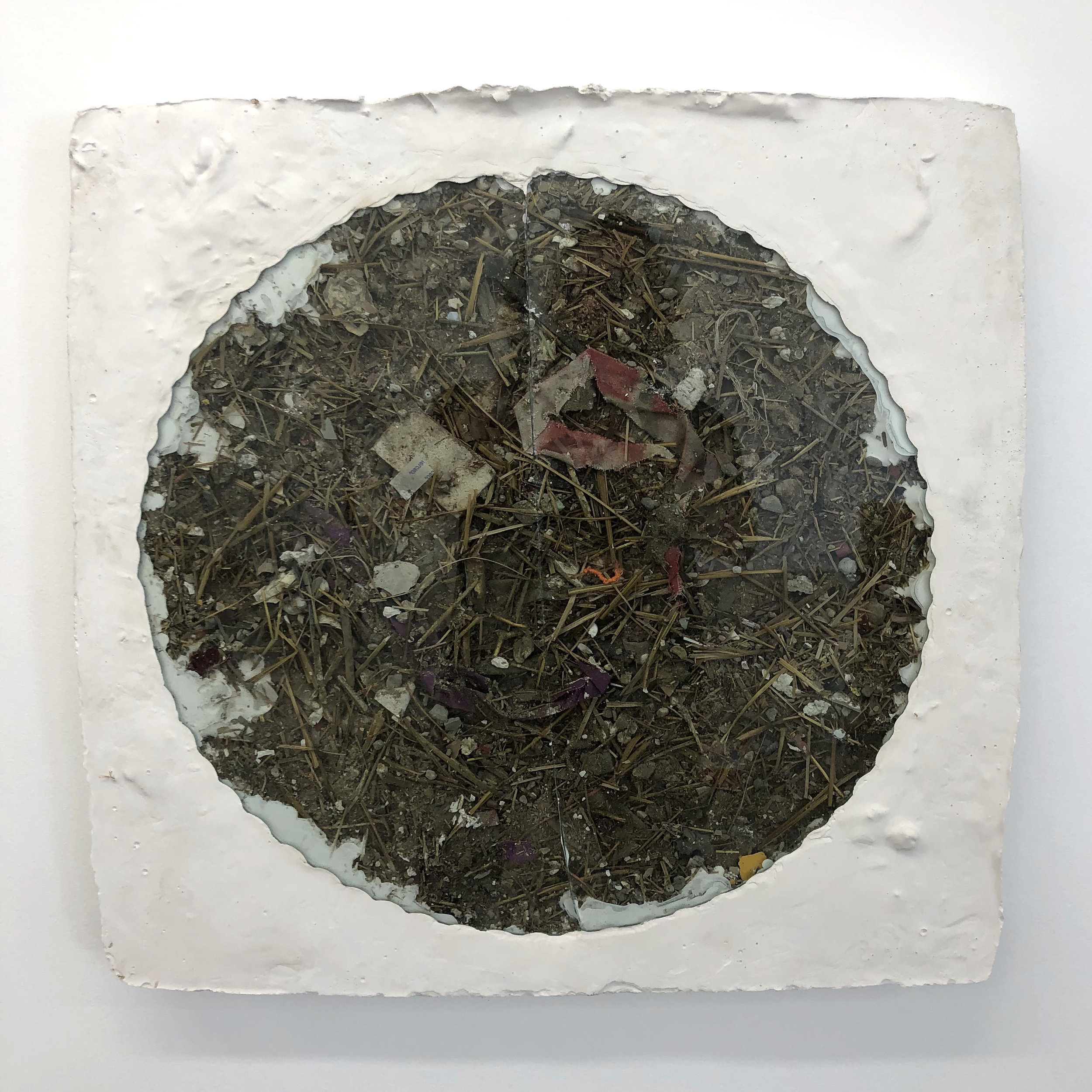 Medallion , 2018 Hydrocal, studios debris, glass table top 28 x 28 x 2-1⁄2 in