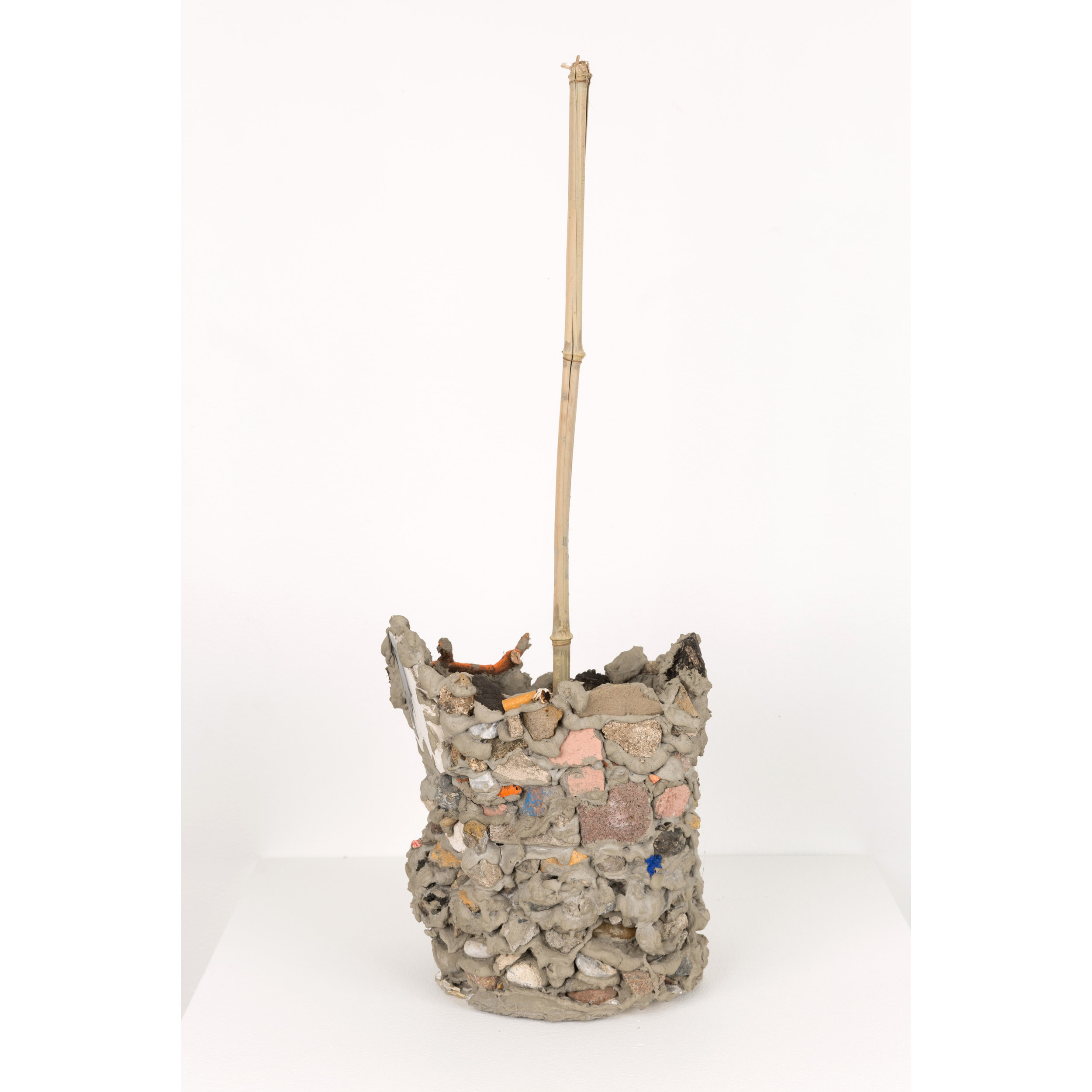 Vessel , 2017 concrete, stones, stick, cigarette butt, shells, bamboo, spray paint 25 x 9 x 7 in