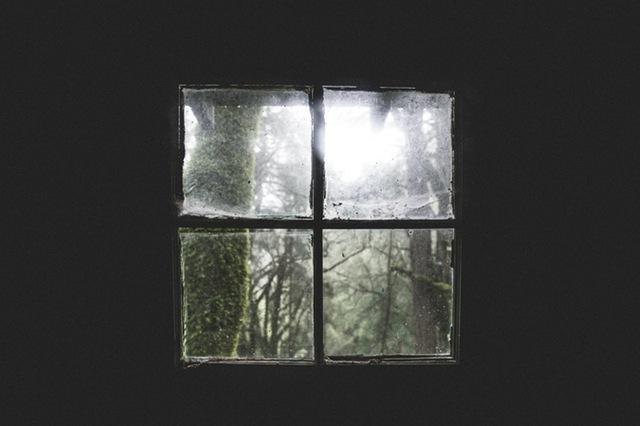 inside dark room looking out a window