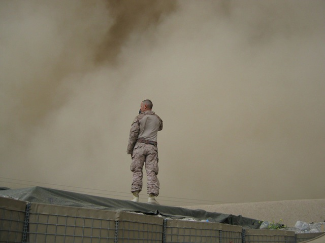 soldier on top of a building