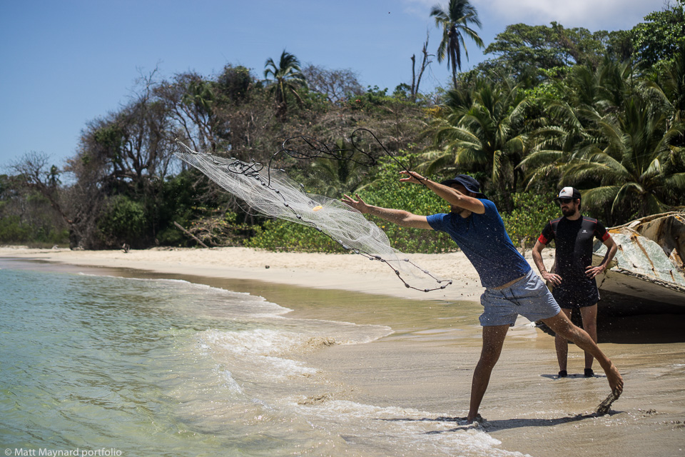 throwing a cast net on a desert island