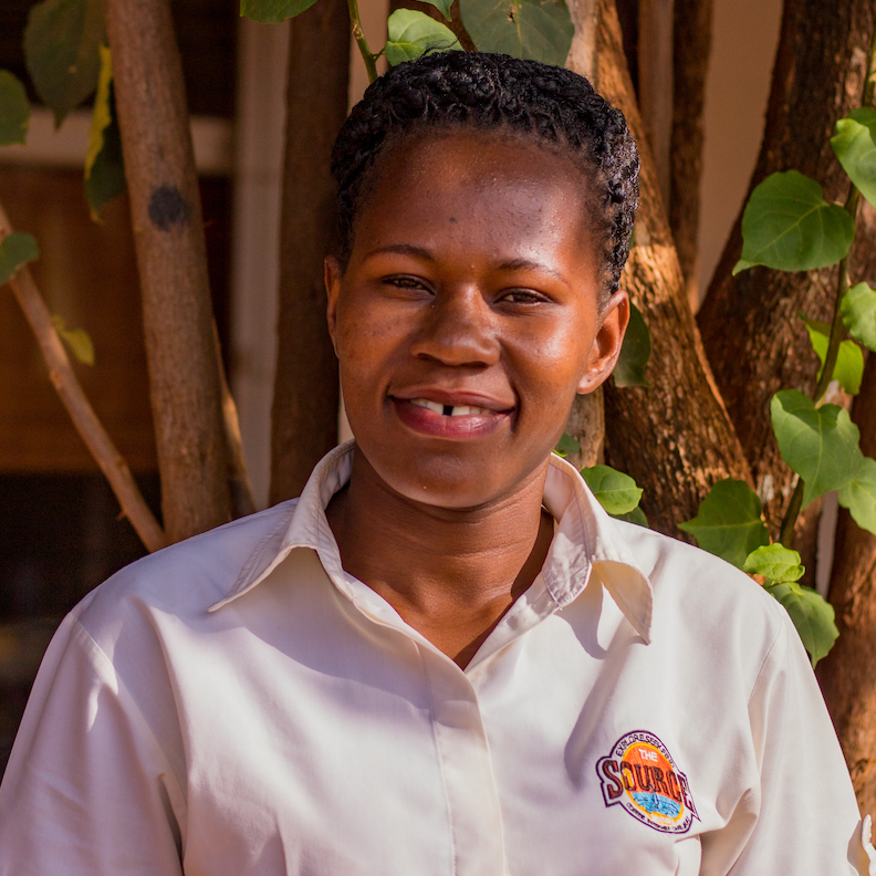 """Joan has worked at the Source since 2014. She has a diploma from Makerere Business School and is pursuing B.B.A. in accounting, She described the Source as a place of """"good coffee, good food and good crafts."""""""