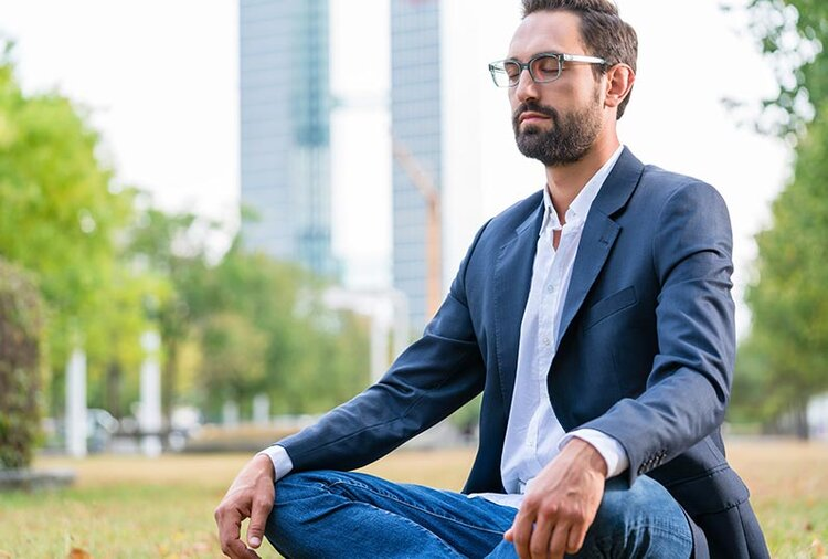 Businessman Meditating in a Park at Lunchtime