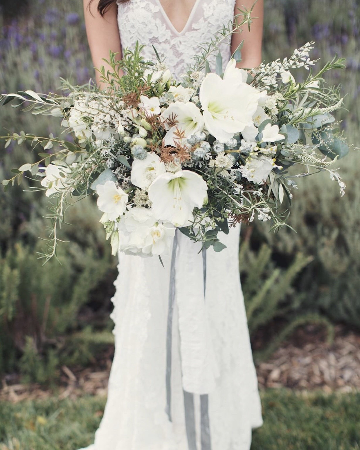 White florals & dusty greenery are brought together in a wildly perfect bouquet. 💐🙌🏼✨🏩🌳🌳 Florals:  @thepollenmill  | Photography:  @anneclairebrun  | Coordination:  @withgraceandloveevents  | Dress:  @madewithlovebridal