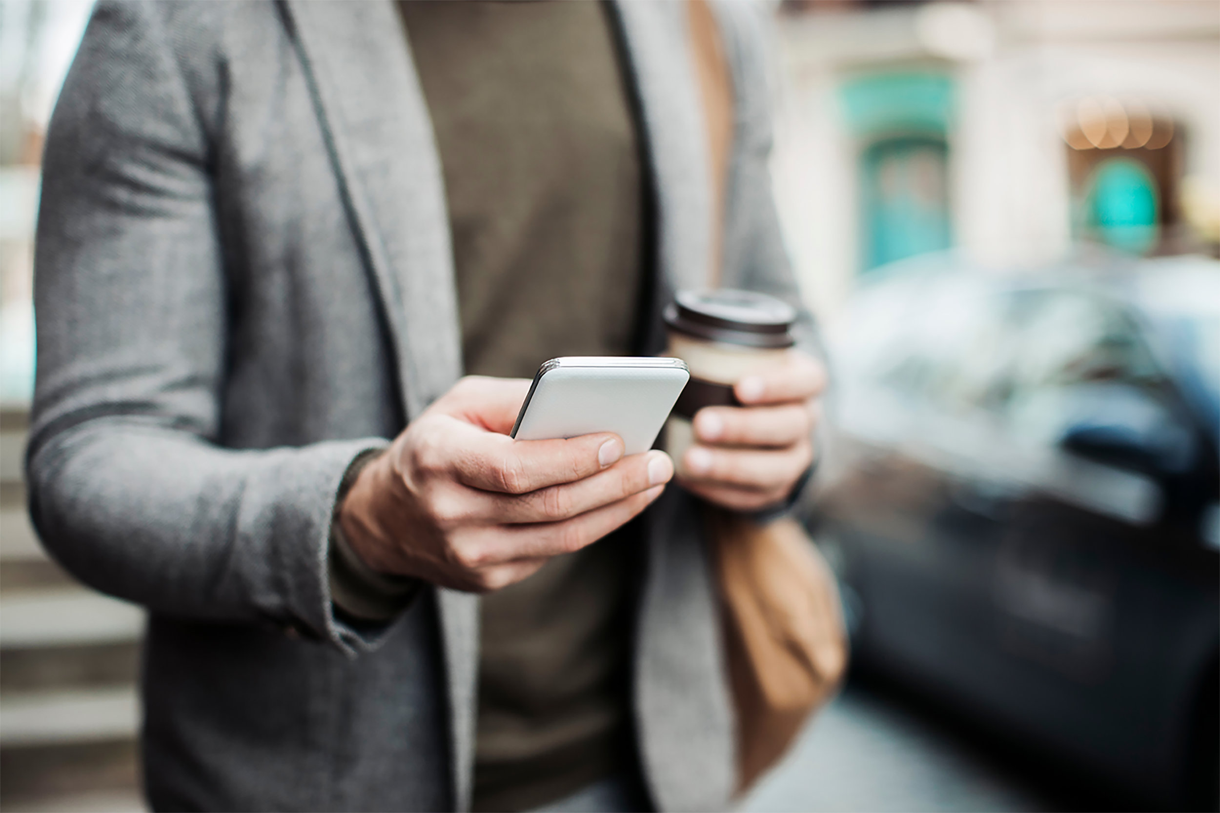 Businessman-using-smart-phone-small.jpg