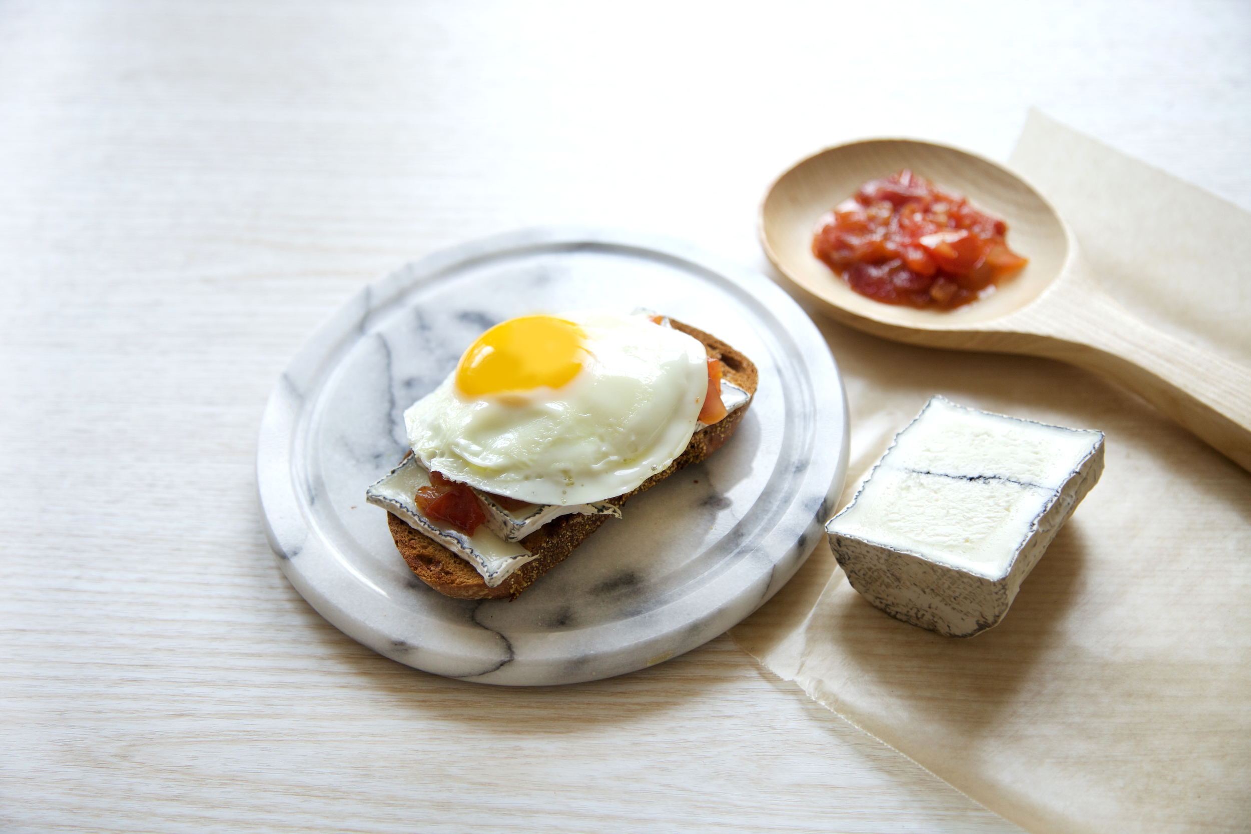 Fried Egg toast with Tomato jam and goat cheese