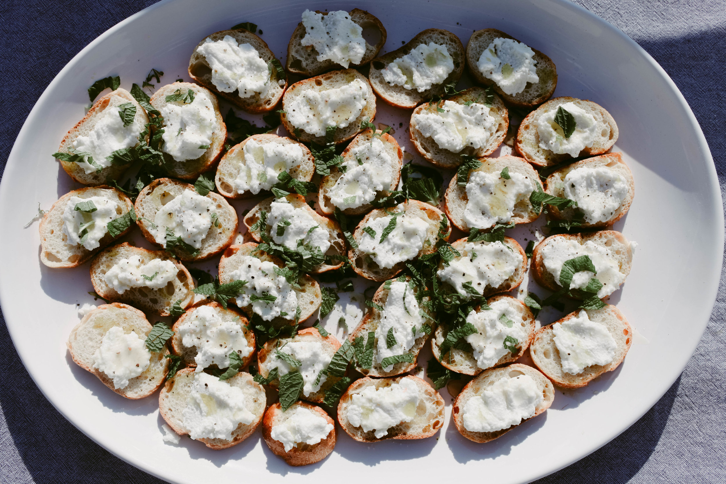Ricotta toast with black pepper and honey and mint