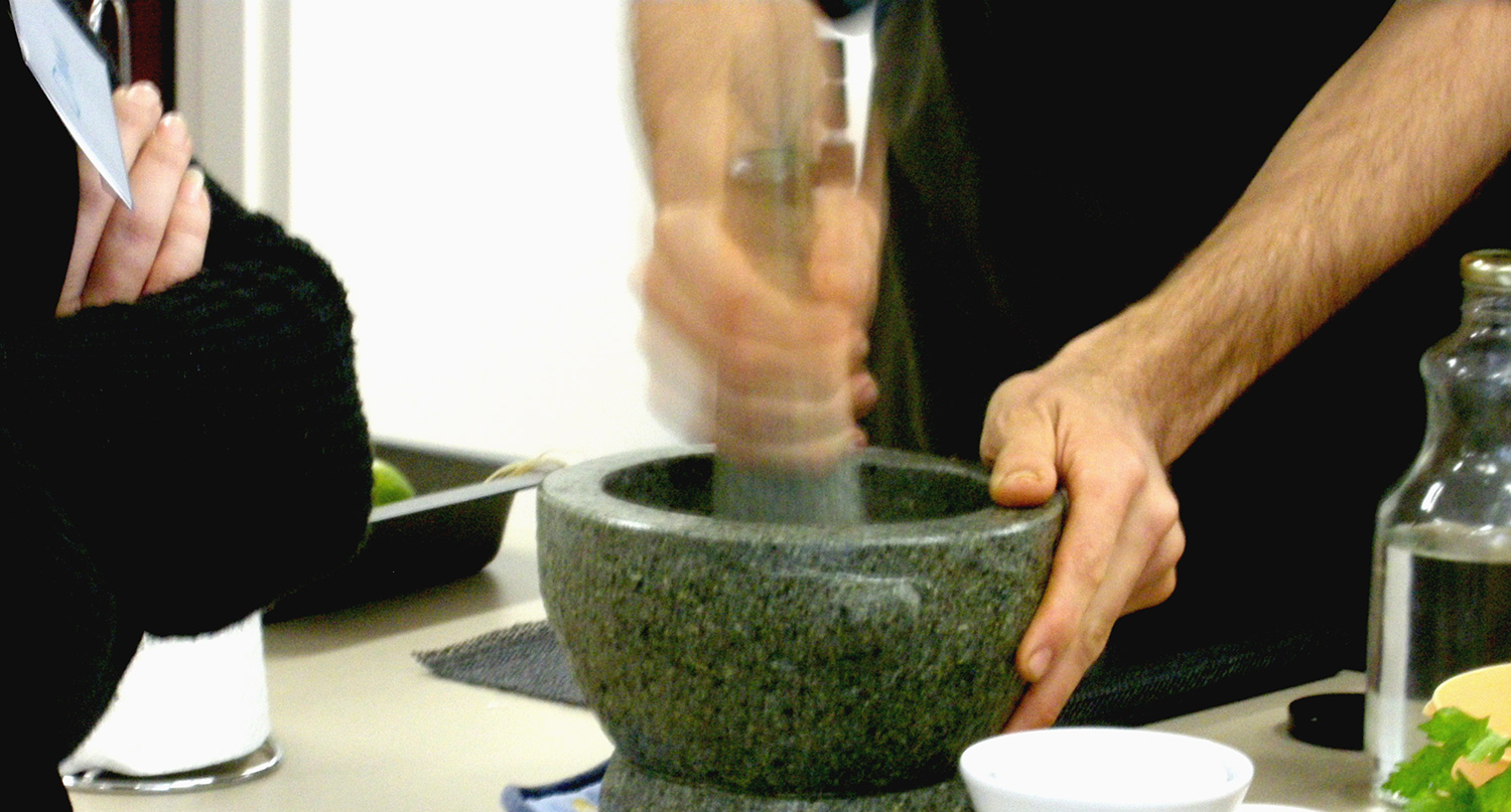 Grinding spices for a 'made from scratch' curry paste.