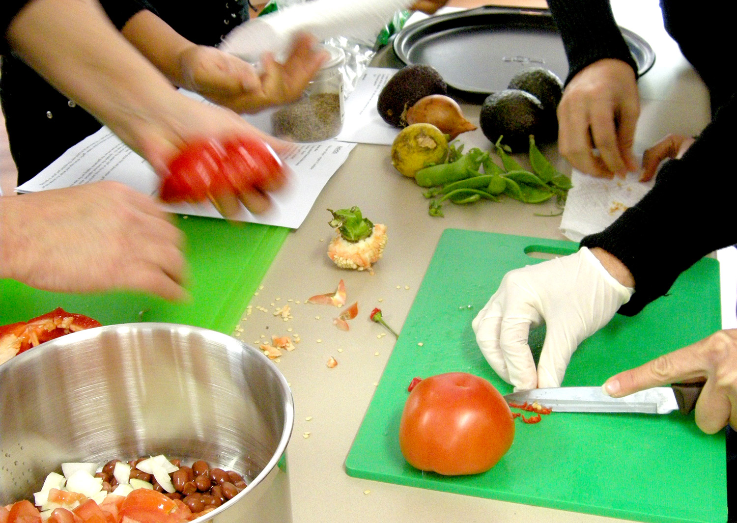 Staff training session. Hands-on work in the kitchen preparing a Mexican kidney bean dish from scratch.