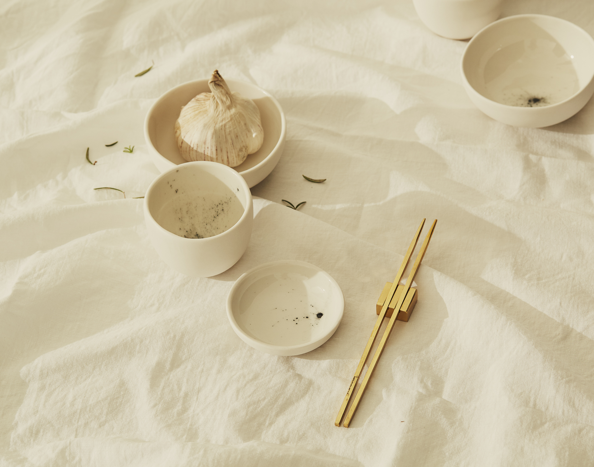 Embellish 'Stardust' ceramics with 'Maibashi' brass chopsticks from Kinnow Cutlery.
