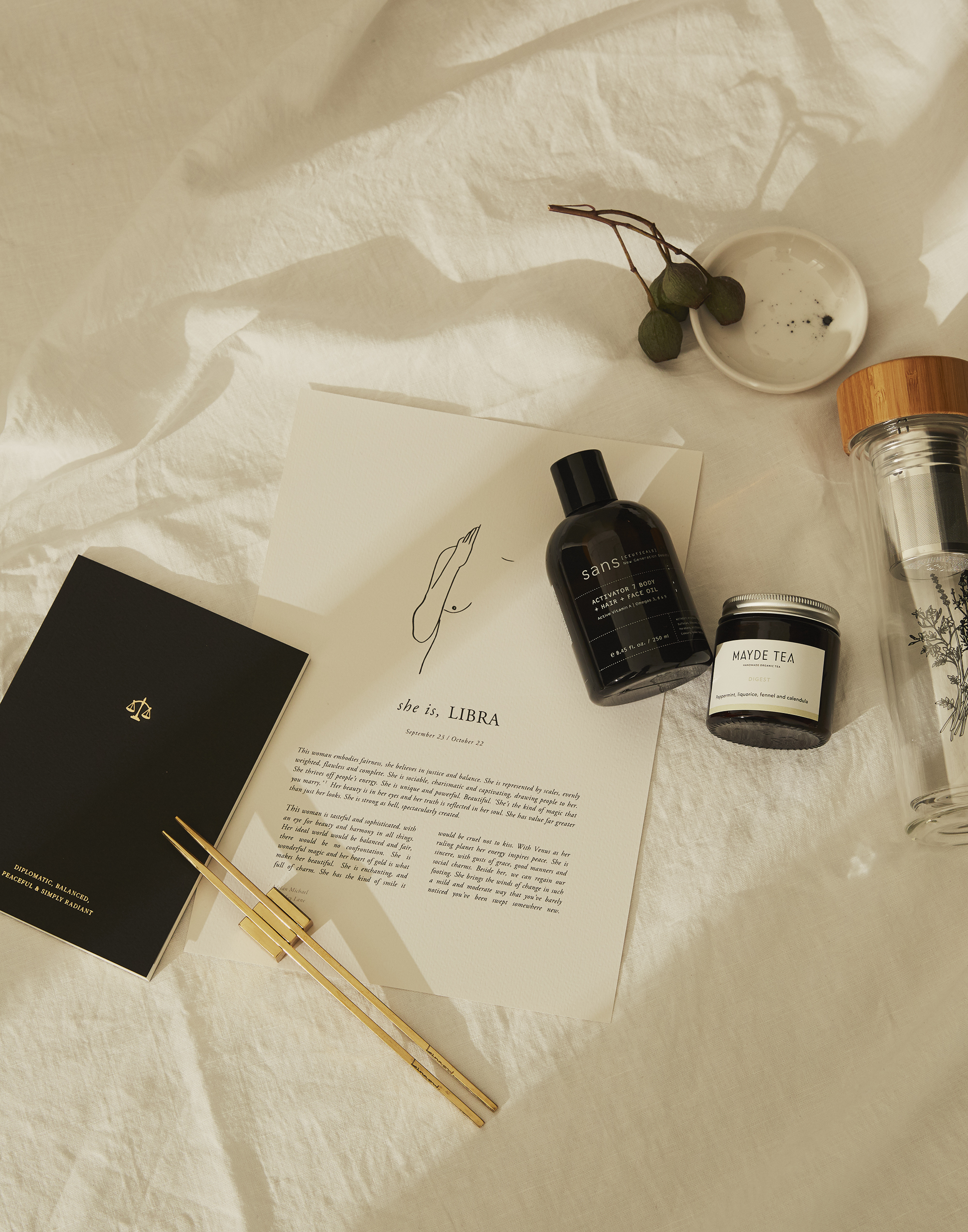 Pictured from left to right are: 'Zodiac Collection' notebook from An Organised Life, 'Maibashi' brass chopsticks from Kinnow Cutlery, 'The Zodiacs' prints from Sunday Lane Studio, Activator 7 Body + Hair + Face Oil from Sans Ceuticals, 'Digest ' Mayde Tea, 'Stardust' ceramics from Studio Enti and Mayde Tea tea flask.