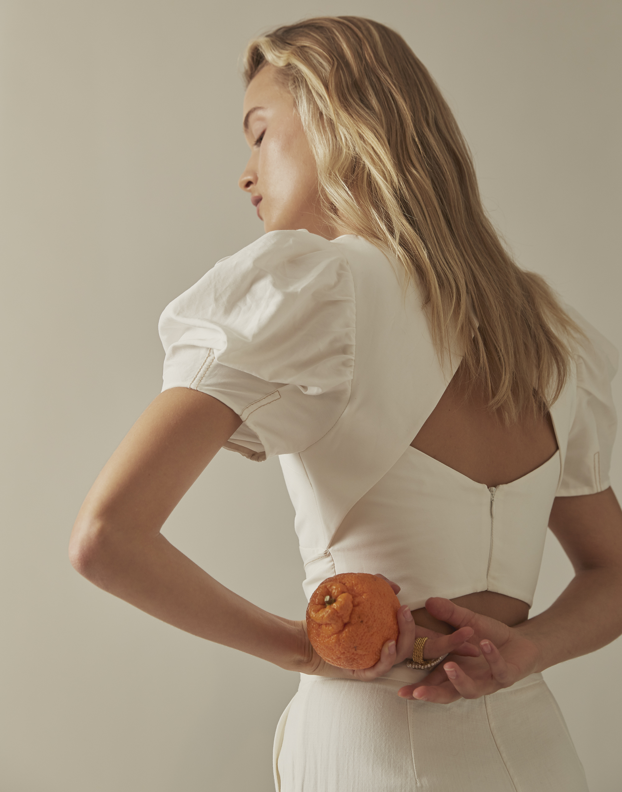 Esti wears Rachel Gilbert top, pants from Marle and a ring by Elena Kougiainou.